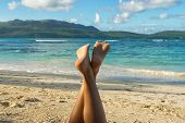 Traveler Girl In Vacation Relaxing On The Beach. Young Girl In Vacation. Close Up Of Girls Legs On T poster