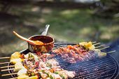 Preparation Of Barbecue, Grilled Skewers On Plate Outdoor. Grilled Shish Kebab On Metal Skewer. Chef poster