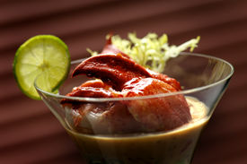 stock photo of christmas dinner  - Image of lobster cocktail with sauce and lime garnish - JPG