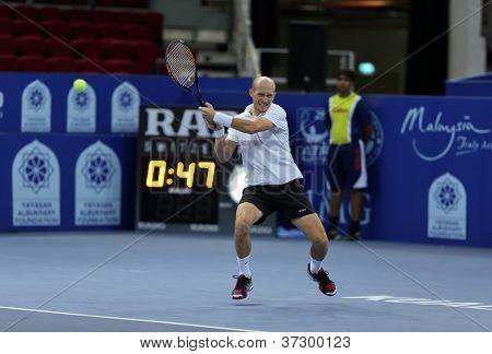 KUALA LUMPUR - SEP 25: Nikolay Davydenko (Russia) plays at the ATP Tour Malaysian Open 2012 on September 25, 2012 at the Putra Stadium, Kuala Lumpur, Malaysia.
