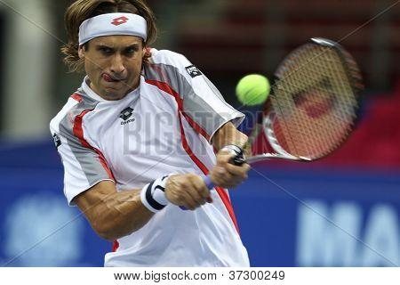 KUALA LUMPUR - SEP 27: David Ferrer of Spain plays his round 2 match at the ATP Tour Malaysian Open 2012 on September 27, 2012 at the Putra Stadium, Kuala Lumpur, Malaysia. He beat Alex Bogomolov Jr.