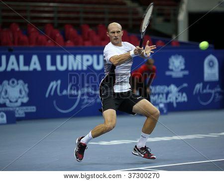 KUALA LUMPUR - SEP 27: Nikolay Davydenko (Rus) plays his round 2 match at the ATP Tour Malaysian Open 2012 on September 27, 2012 at the Putra Stadium, Kuala Lumpur, Malaysia. He beat Denis Istomin.