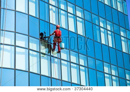 Washer wash the windows on  high office building