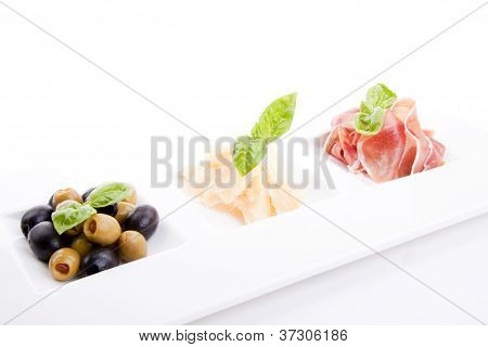 Deliscious Antipasti Plate With Parma Parmesan And Olives