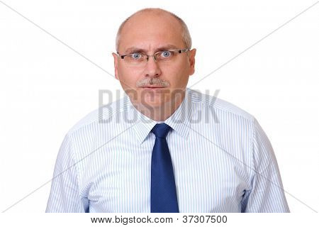 Close portrait of surprised senior businessman in blue shirt looking through glasses, isolated on white