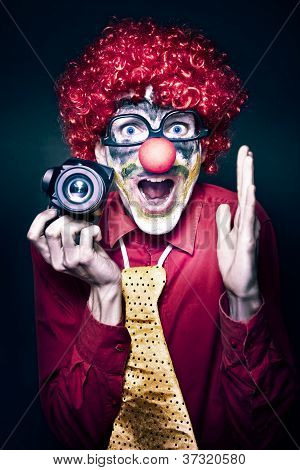 Excited Clown With Camera At Kids Birthday Party
