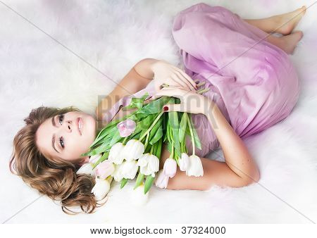 Romantic Lovely Young Girl With Bouquet Of Fresh Tulips