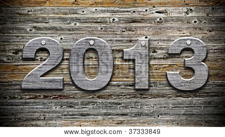 """2013"" number on old wood background"