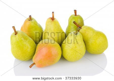 A group of fresh ripe Bartlett Pears on a white background with reflection. Horizontal format.