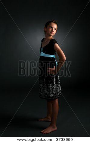Studio Portrait Of Pretty Girl In Black Dress
