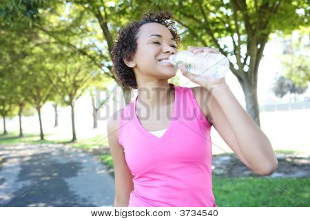 Jogger Drinking Water In Park