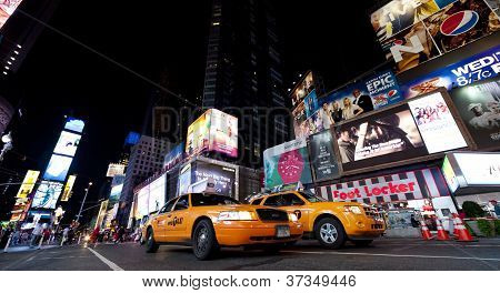 New York City - Sept 18: Times Square, Featured With Broadway Theaters, Taxi Cabs And Animated Led S