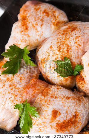 Raw Chicken With Spice On Frying Pan
