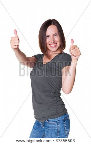joyful young woman in casual wear showing thumbs up over white background