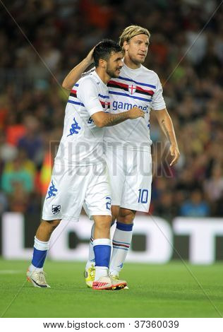 BARCELONA - AUG, 20: Maxi Lopez & Roberto Soriano of UC Sampdoria celebrating goal during Joan Gamper Trophy match against FC Barcelona at Nou Camp Stadium in Barcelona, Spain. August 20, 2012