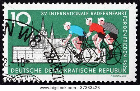 Postage stamp Germany 1962 Cyclists and Hradcany, Prague