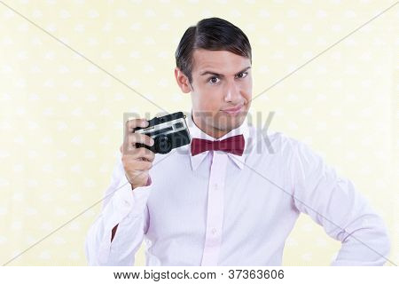Retro styled man posing with rangefinder camera