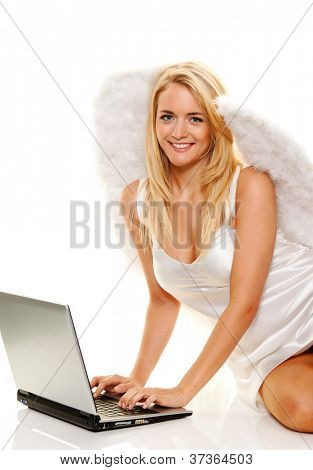blonder engel takes at christmas wishes with laptop.