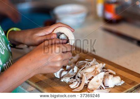 Kid Peeling Mushrooms