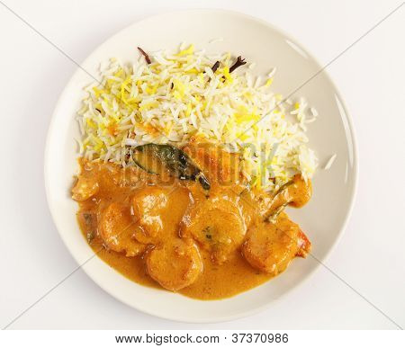 A prawn korma curry served with pilau rice seen from above