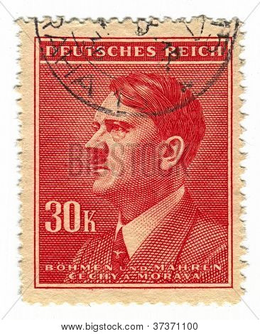 GERMANY - CIRCA 1937: A stamp printed in Germany shows image of Adolf Hitler an Austrian-born German politician and the leader of the Nazi Party, in red, circa 1937.