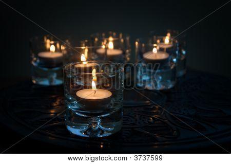 Six Tealights On Carved Wood