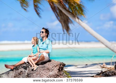 Happy father and his adorable little daughter enjoying tropical beach