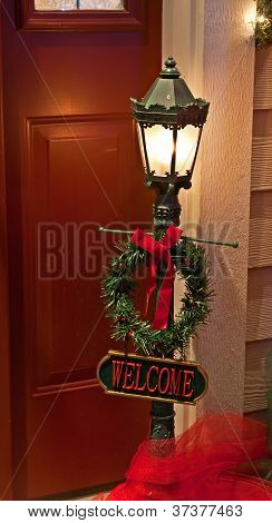 Holiday Doorway Light With Welcome Sign