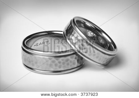 Two Titanium Silver Wedding Bands On White
