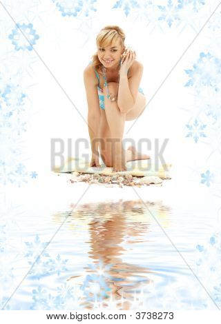Blond In Blue Bikini With Shell On White Sand