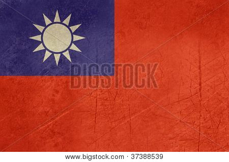Grunge sovereign state flag of country of Republic of China in official colors.