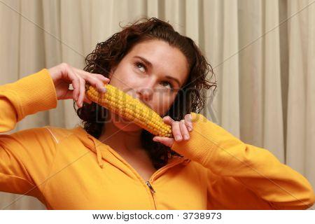 Girl Eating A Boiled Corn