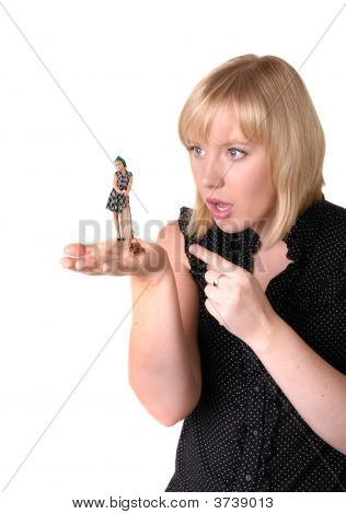 Girl Extends Palm Holding Small Cleaning Lady