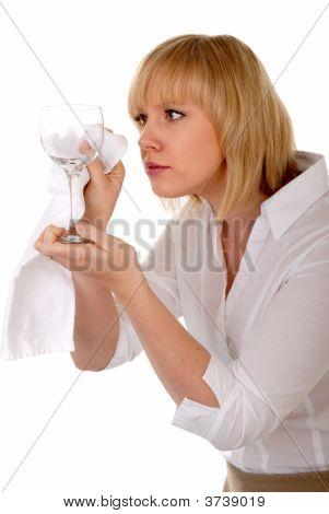 Pretty Blond Waitress Inspects Wineglass