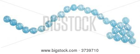 Blue Marbles Arranged In A Squiggly Arrow.