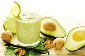 stock photo of walnut  - Fresh smoothie of avocados - JPG