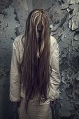 foto of gothic hair  - zombie girl with loong hair in an abandoned building - JPG