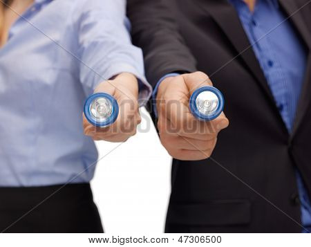 picture of business team holding pocket flashlights