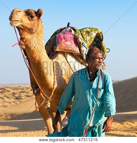 Camel Man Leads His Camel Across The Thar Desert
