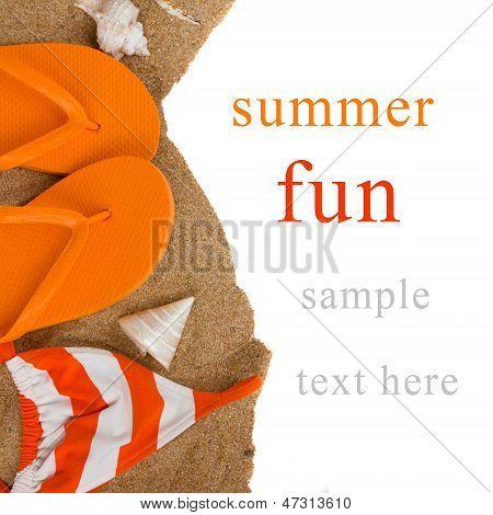 orange flip flops and swimming suit on sand