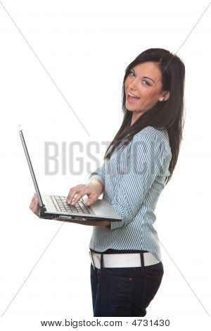 Young Smiling Successful Woman With A Laptop Computer