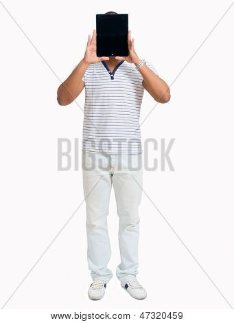 Young African Man Hiding Face With Digital Tablet Over White Background