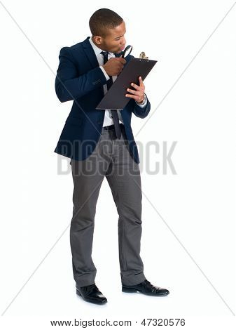 Businessman Looking Clipboard Through Magnifying Glass Over White Background