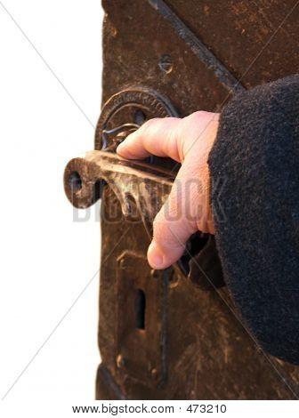 Hand On An Antique Door - Opening