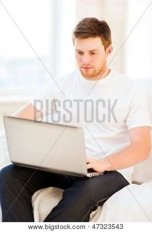 handsome man working with laptop at home