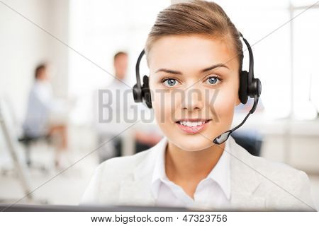 friendly female helpline operator with headphones in call centre