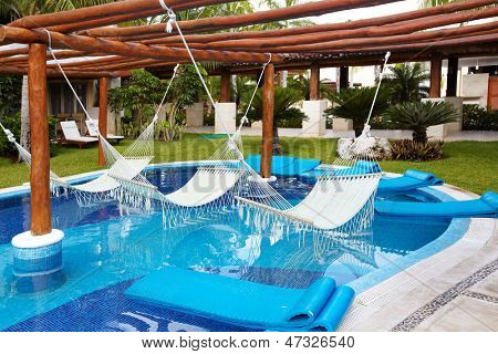 Swimming pool and hammock. Luxury exotic resort.