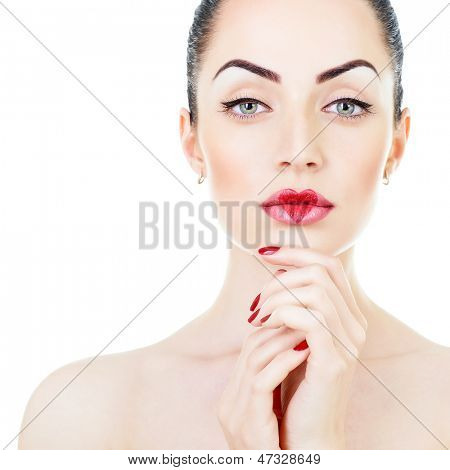 Beautiful young woman with creative makeup with heart on her lips posing at studio over white background