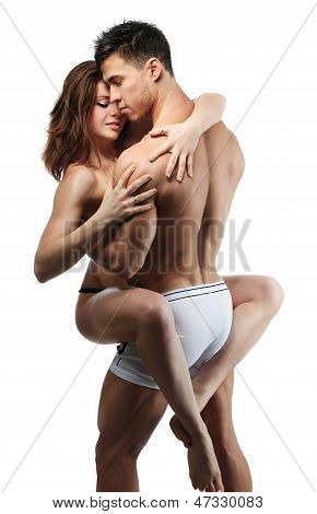 Beautiful passionate couple over white