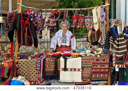 BIOGRAD/CROATIA - MAYc31: Unidentified lady in traditional clothes selling traditional Croatian clot